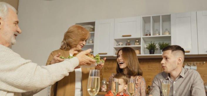 cheerful family having dinner