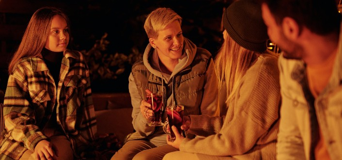 friends with mulled wine at bonfire