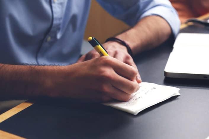 a man writing notes