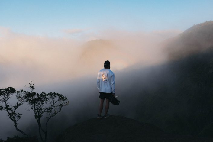 Man standing on a foggy mountain top.