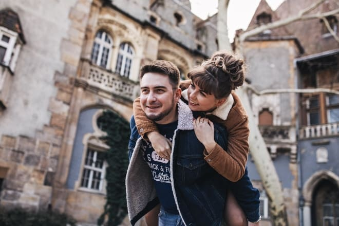 man carrying his woman on a piggyback ride - Love puns