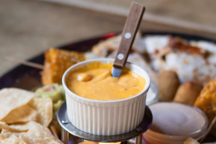 Melted cheese in a bowl.