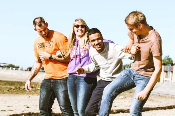 four people having fun under the sun
