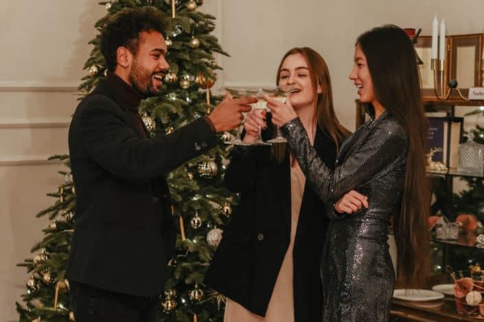 three people having a toast during Christmas season