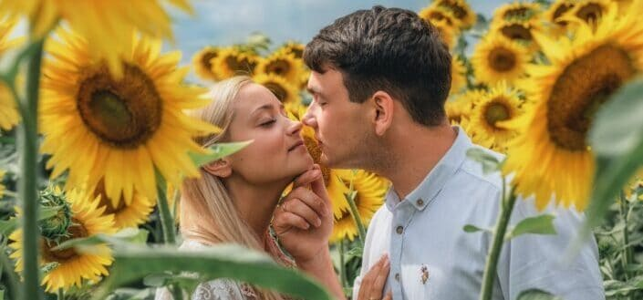 romantic couple in a sunflower field