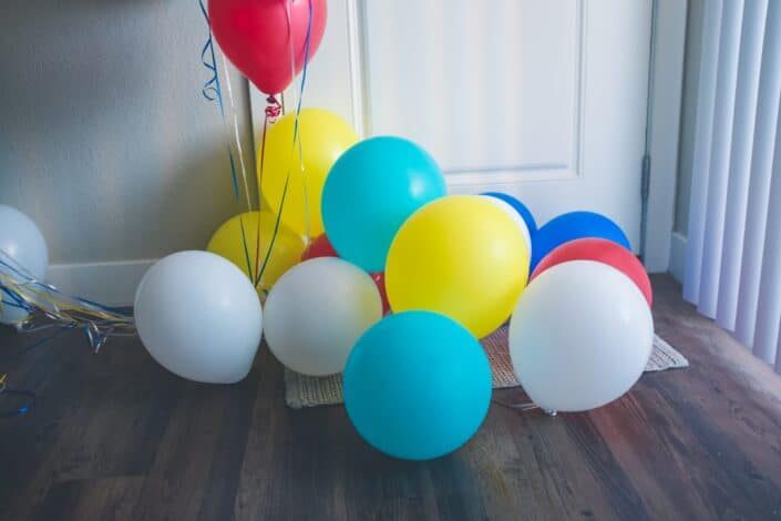 different colored balloons on the floor