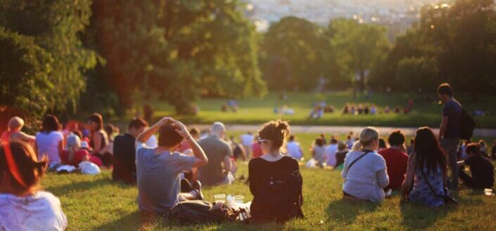 Group of people enjoying music concert in open field