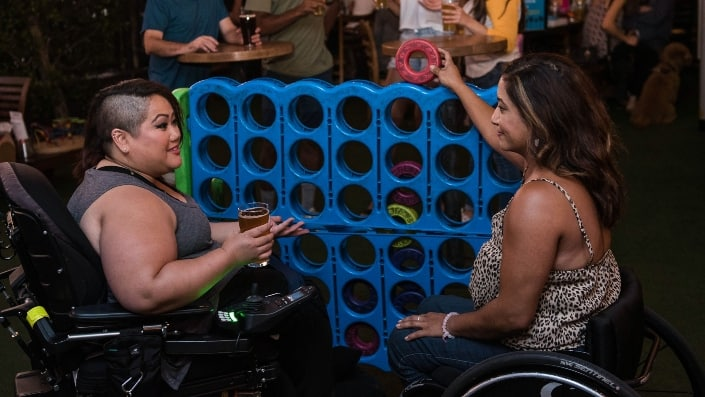 two women on wheelchairs playing a game