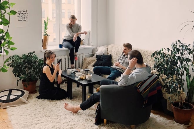 people hanging out in living room - Christmas Party Games For Adults