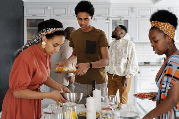 three people preparing food