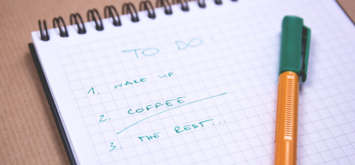 notebook with a to-do list and a pen