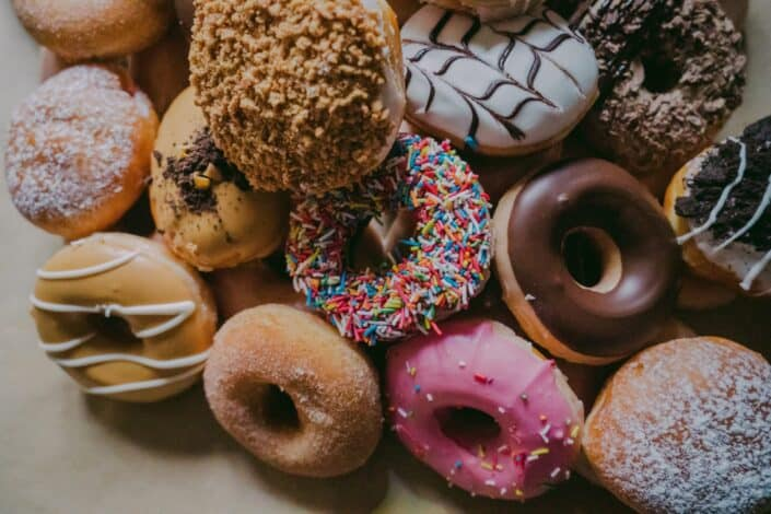 dozens of different flavored donuts