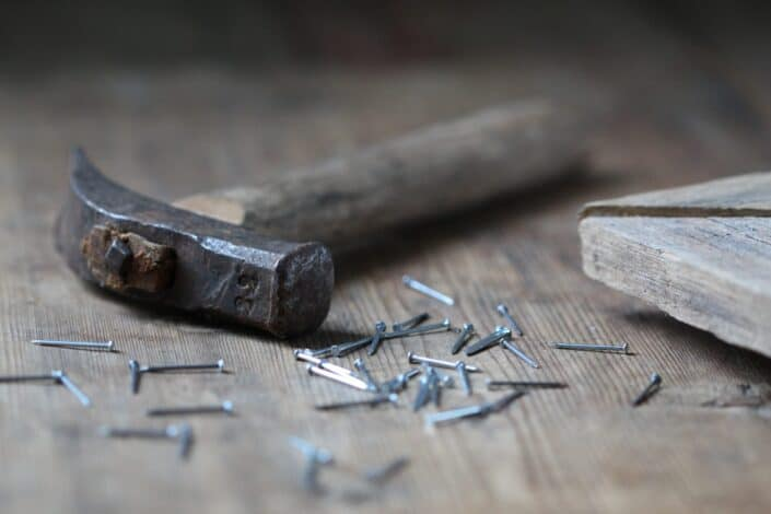 nails and hammer on wood