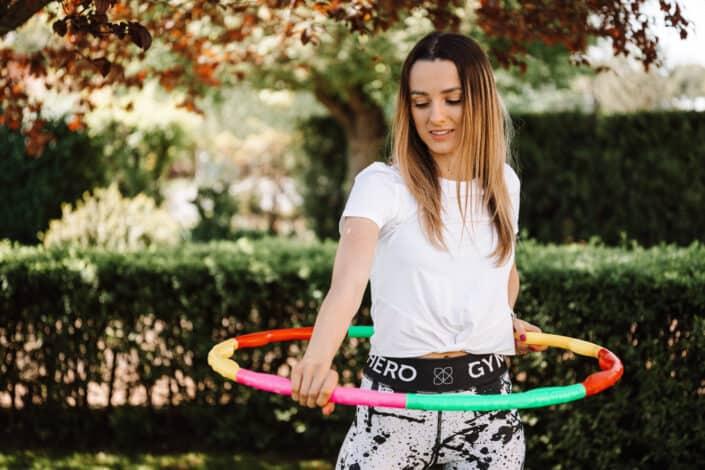 woman with a hoola hoop around her waist