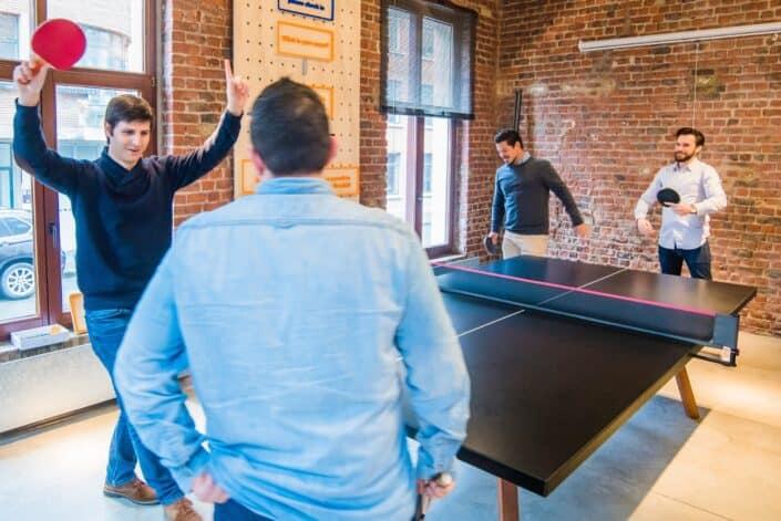 four men playing pingpong
