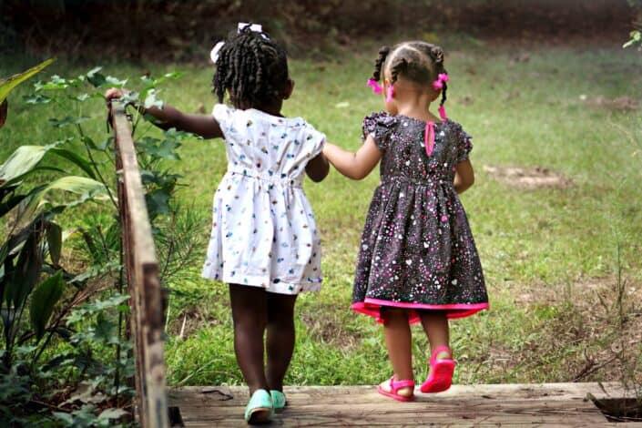 two girls walking side by side