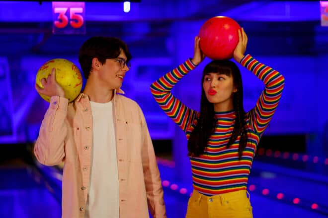 couple playing retro bowling - minute to win it games for teens