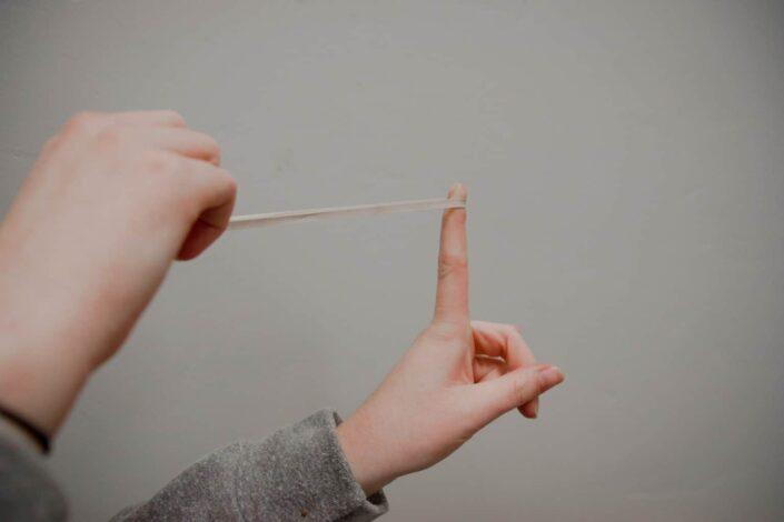 finger slingshot with a rubber band