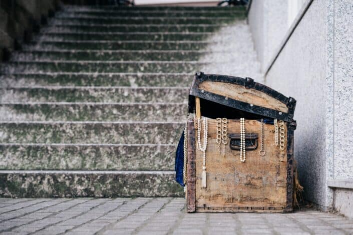 slightly open treasure chest at the foot of a flight of stairs