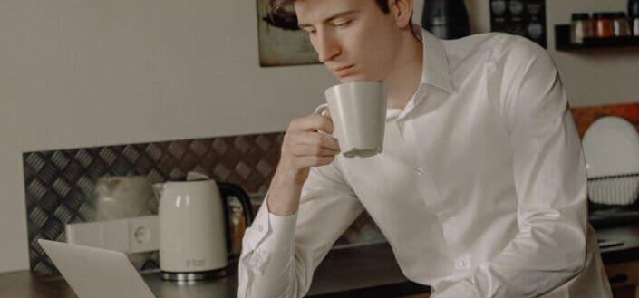 man drinking coffee from a mug