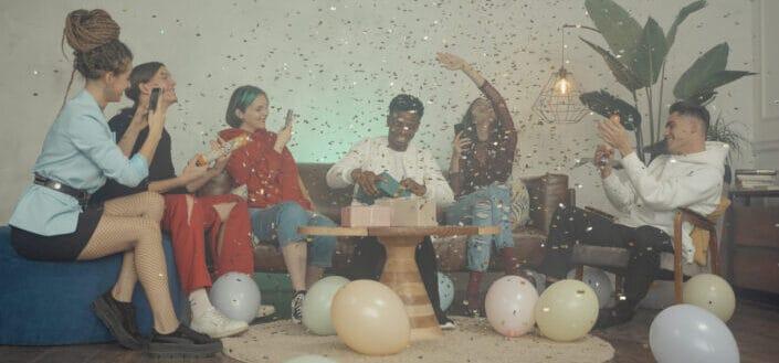 Friends having fun enjoying the confetti