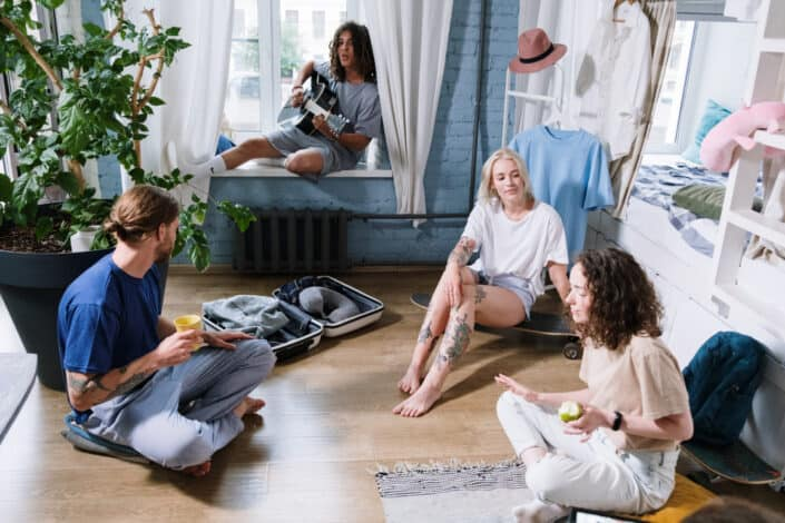 A group of people hanging out in a room