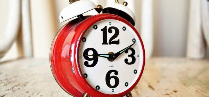 a red, vintage alarm clock