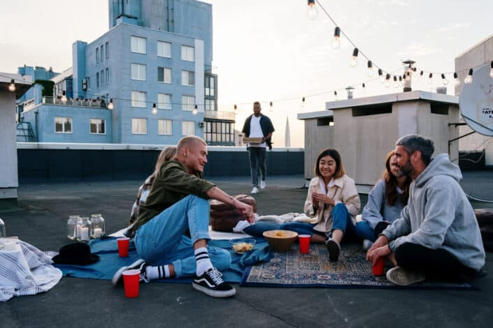 A group of friends talking on the rooftop