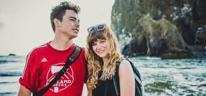 Happy couple having a beach getaway