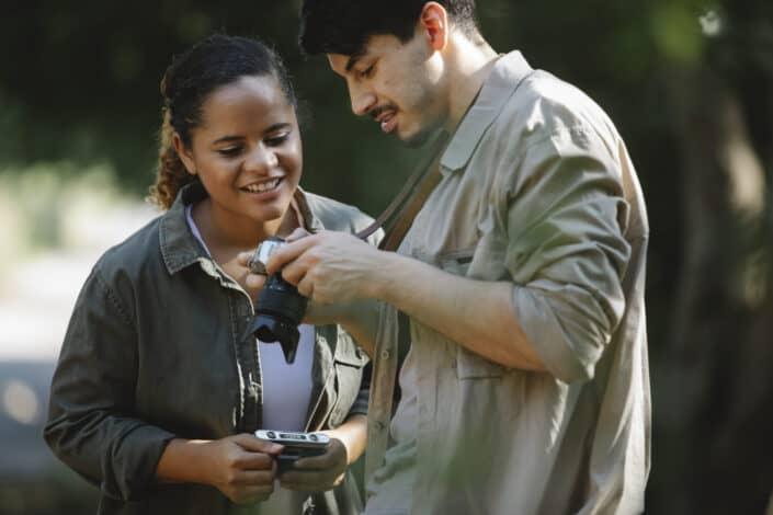 Couple examining their camera