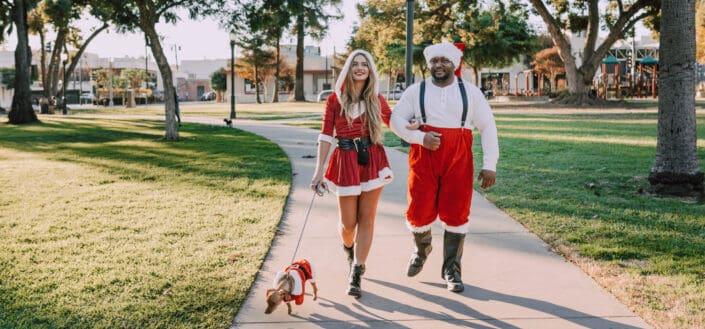 Couple wearing Christmas costumes