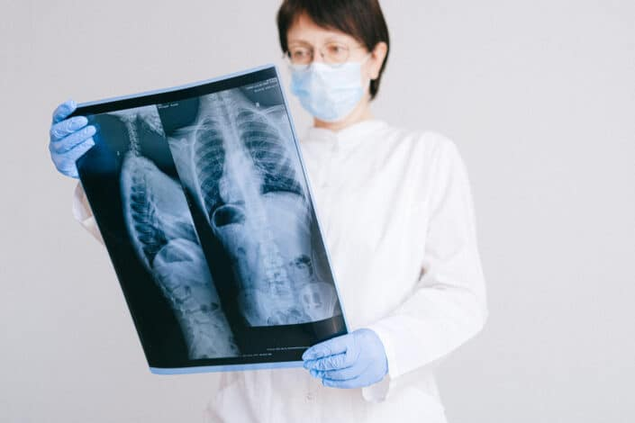 doctor looking at x-ray clipart