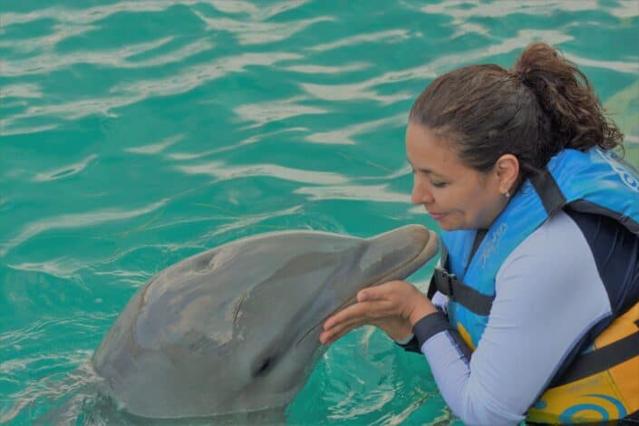 woman playing with dolphin