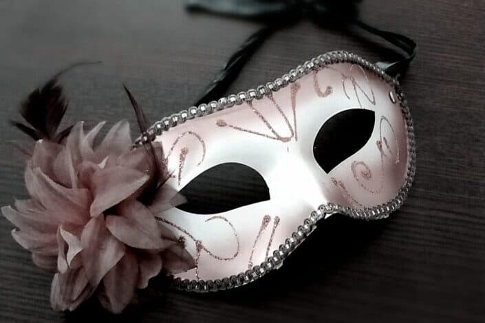 Carnival mask decorated with pink flower