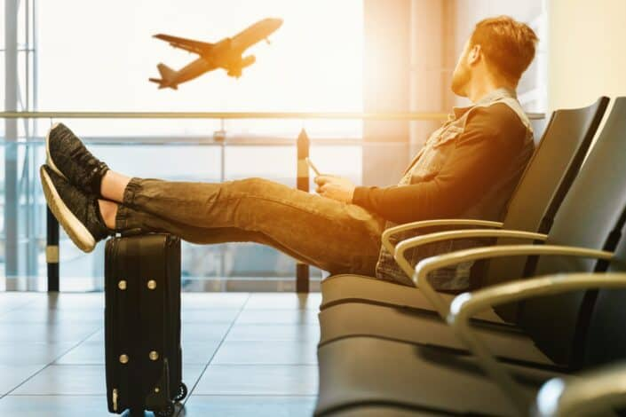 Man sitting while waiting for his flight