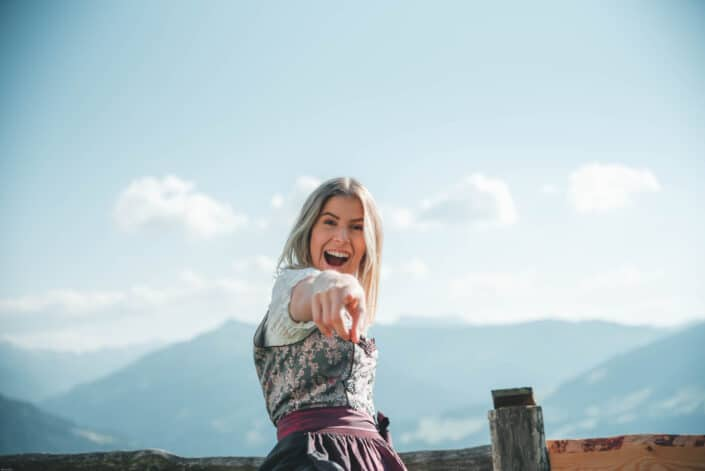smiling woman pointing with right hand
