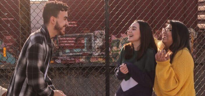 Guy making two girls laugh