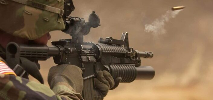 military man shooting with his rifle
