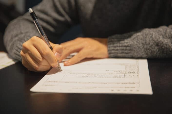 man filling up a form