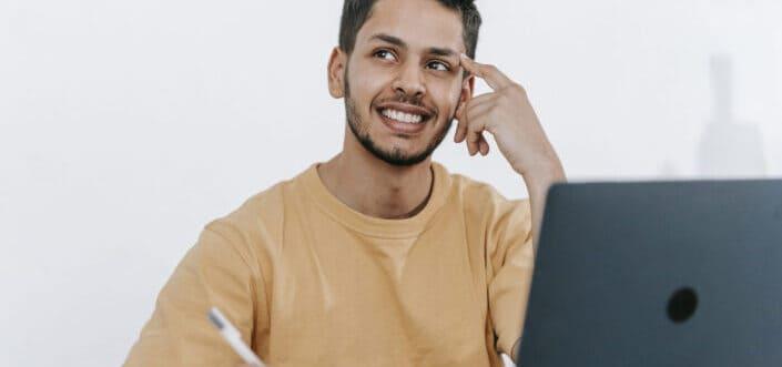 Man thinking while writing notes