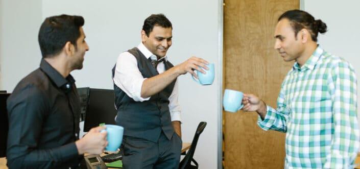 Office men drinking coffee at breaktime