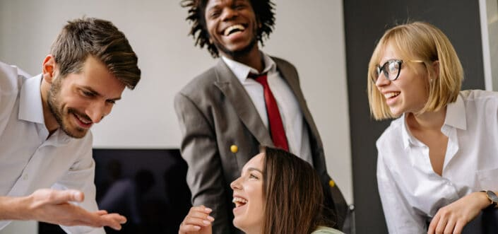Young office professionals laughing together