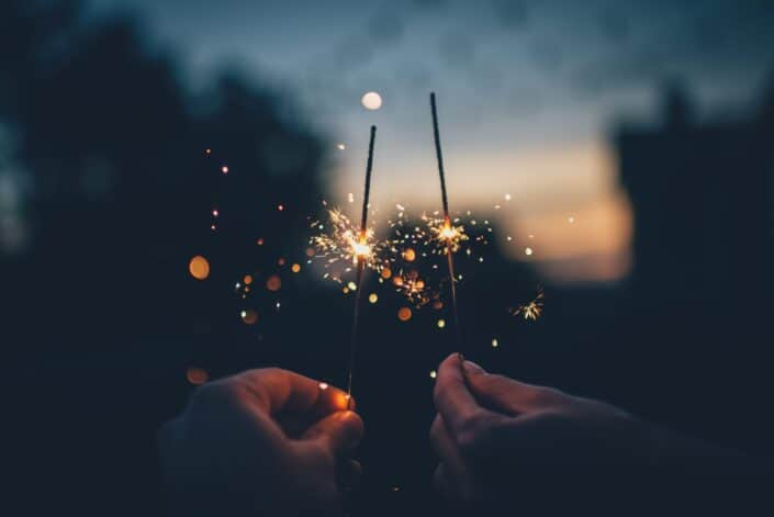 Sparklers being held by two hands
